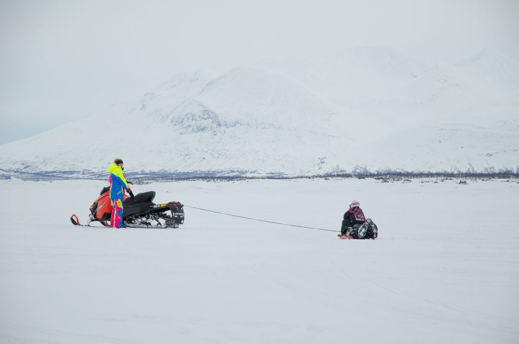 snowmobile in swedish lapland - explore a little more