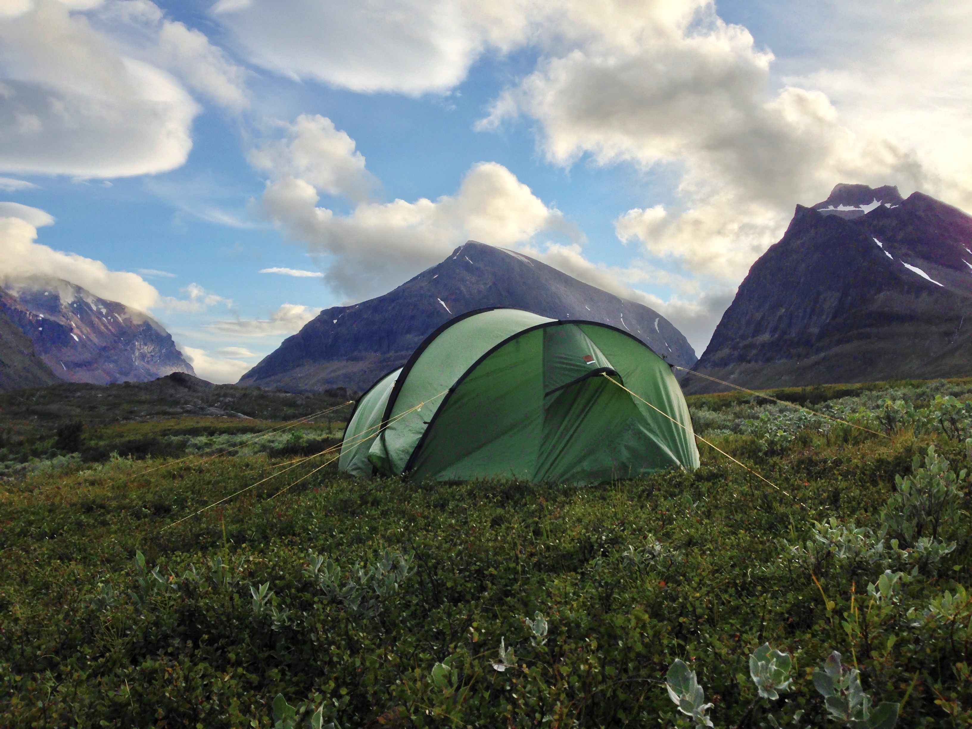 Camping by the foot of the mountain.
